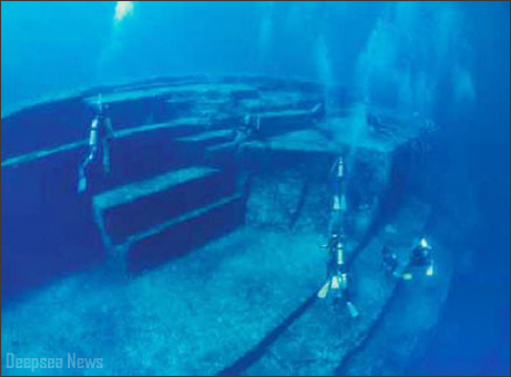 Underwater ruin with divers